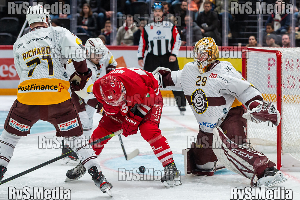 LAUSANNE, SWITZERLAND - NOVEMBER 23: #95 Tyler Moy of Lausanne HC tries to score against $m29$ during the Swiss National League game between Lausanne HC and Geneve-Servette HC at Vaudoise Arena on November 23, 2019 in Lausanne, Switzerland. (Photo by Monika Majer/RvS.Media)
