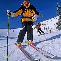 SKIING, Montana. Patrick Shanahan & Bobby Model<br /> (MR), cruise deserted Toni Matt run at The Big Mountain Ski Area, Whitefish.