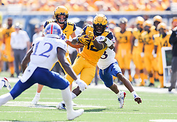 Oct 6, 2018; Morgantown, WV, USA; West Virginia Mountaineers wide receiver Gary Jennings Jr. (12) catches a pass and runs for extra yards during the second quarter against the Kansas Jayhawks at Mountaineer Field at Milan Puskar Stadium. Mandatory Credit: Ben Queen-USA TODAY Sports