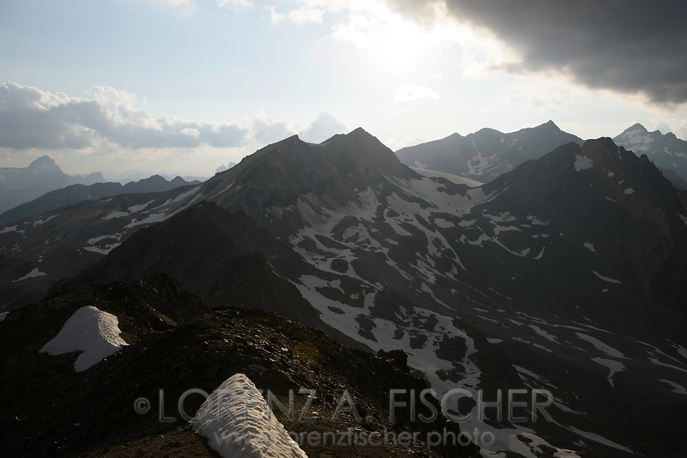 View from the Corn Suvretta over the Albula Alps with Piz Surgonda, Calderas, d'Err and Jenatsch on a nice summer evening in July with heap clouds, Engadin, Grisons, Switzerland