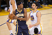 Golden State Warriors center Zaza Pachulia (27) defends Indiana Pacers center Myles Turner (33) in the first quarter at Oracle Arena in Oakland, Calif., on December 5, 2016. (Stan Olszewski/Special to S.F. Examiner)