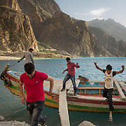 Punjabi tourists getting off a tourist boats in a wind storm.<br /> Around Attabad lake, upper Hunza.