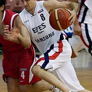 Efes Pilsen's Igor RAKOCEVIC (R) during their Turkish Basketball league Play Off first leg match Efes Pilsen between Erdemir at the Ayhan Sahenk Arena in Istanbul Turkey on Thursday 29 April 2010. Photo by Aykut AKICI/TURKPIX