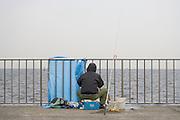 person fishing at the sea coast Japan near Tokyo