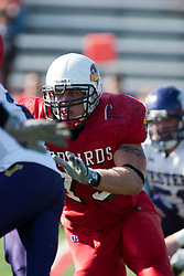 29 October 2005: Redbird Justin Martindale circles his prey. With a final score of 31 - 17, Western Illinois University Leathernecks collared the Illinois State University Redbirds knocking them from their 18th ranked perch at Hancock Field on Illinois State's campus in Normal IL