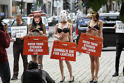 July 4, 2017 - Berlin, Berlin-Mitte, Germany - Bikini-clad PETA supporters demonstrate with big leather bags at the beginning of the Fashion Week in front of the Jahndorf-Kaufhaus in Berlin Mitte. (Credit Image: © Simone Kuhlmey/Pacific Press via ZUMA Wire)