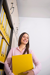 Young woman pretty working in office filing folder