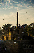 """4th February 2016, New Delhi, India. View of the ruins of Feroz Shah Kotla in New Delhi, India on the 4th February 2016<br /> <br /> PHOTOGRAPH BY AND COPYRIGHT OF SIMON DE TREY-WHITE a photographer in delhi<br /> + 91 98103 99809. Email: simon@simondetreywhite.com<br /> <br /> People have been coming to Firoz Shah Kotla to pray to and leave written notes and offerings for Djinns in the hopes of getting wishes granted since the late 1970's. Jinn, jann or djinn are supernatural creatures in Islamic mythology as well as pre-Islamic Arabian mythology. They are mentioned frequently in the Quran  and other Islamic texts and inhabit an unseen world called Djinnestan. In Islamic theology jinn are said to be creatures with free will, made from smokeless fire by Allah as humans were made of clay, among other things. According to the Quran, jinn have free will, and Iblīs abused this freedom in front of Allah by refusing to bow to Adam when Allah ordered angels and jinn to do so. For disobeying Allah, Iblīs was expelled from Paradise and called """"Shayṭān"""" (Satan).They are usually invisible to humans, but humans do appear clearly to jinn, as they can possess them. Like humans, jinn will also be judged on the Day of Judgment and will be sent to Paradise or Hell according to their deeds. Feroz Shah Tughlaq (r. 1351–88), the Sultan of Delhi, established the fortified city of Ferozabad in 1354, as the new capital of the Delhi Sultanate, and included in it the site of the present Feroz Shah Kotla. Kotla literally means fortress or citadel."""