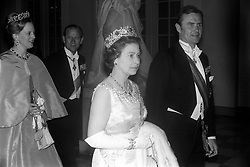 Queen Elizabeth II and the Duke of Edinburgh, accompanied by Queen Margrethe of Denmark and Prince Henrik, when they attended a State banquet at Christiansborg Castle, Copenhagen.