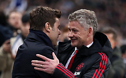 Tottenham Hotspur manager Mauricio Pochettino (left) greets Manchester United interim manager Ole Gunnar Solskjaer
