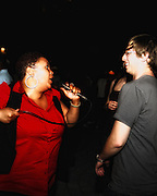 People dancing, partying, and have a good time at Lee Jones's open air Sundae dance party in 2009. This weekly event is held at the the Piazza at Schmidt's in Northern Liberties in Philadelphia each Sunday. This party featured Lady Alma (Alma Horton) and Mark de-Clive Lowe in a live performance.