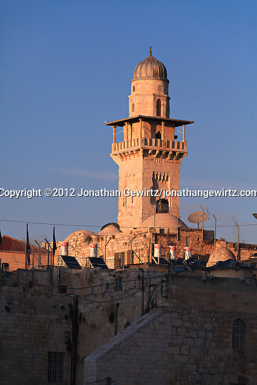 The minaret of a mosque adjacent to the Dome of the Rock is visible from the area of the Western Wall in Jerusalem. WATERMARKS WILL NOT APPEAR ON PRINTS OR LICENSED IMAGES.