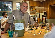 """Bartender servign frozen Covfefe with kahlua at the """"Ear of Steve"""" fundraising  event in Abita Springs, Louisiana on June 11."""