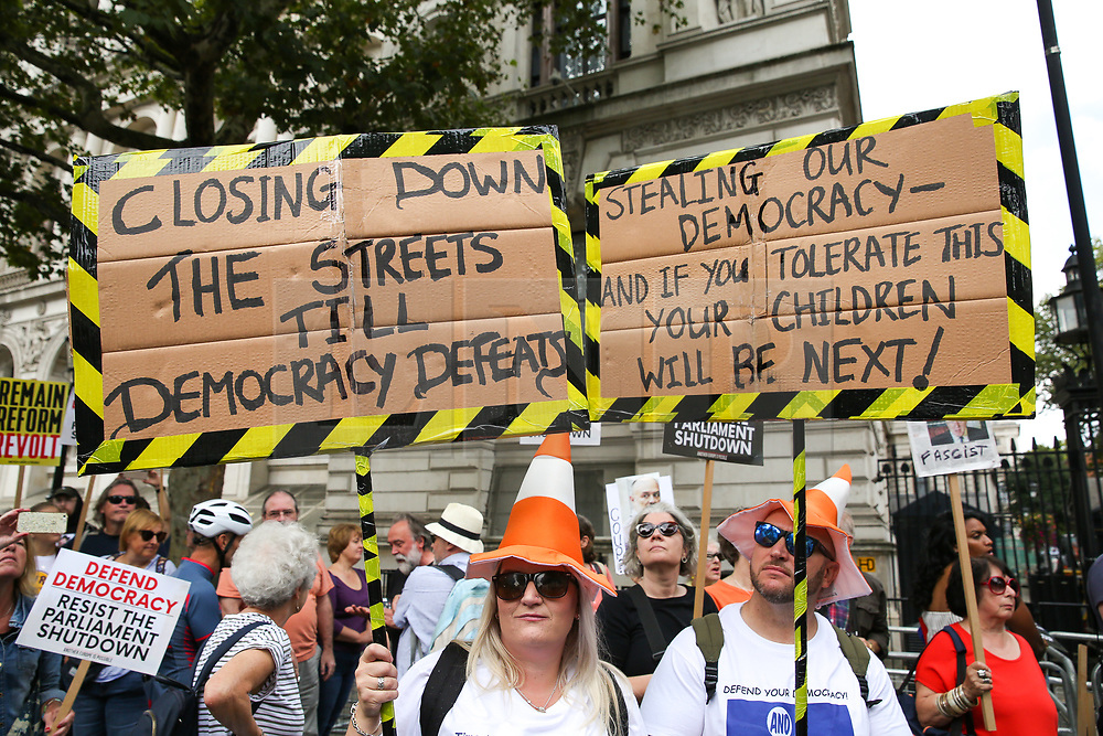 © Licensed to London News Pictures. 31/08/2019. London, UK. Tens of thousands of protesters demonstrates outside Downing Street in London against British Prime Minister Boris Johnson's plans to suspend parliament for five weeks ahead of a Queens Speech on 14 October, just two weeks before the UK is set to leave the EU. Photo credit: Dinendra Haria/LNP