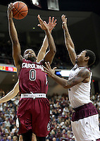South Carolina's Sindarius Thornwell (0) makes a basket over Texas A&M's Anthony Gilder (11) during the second half of an NCAA college basketball game, Saturday, Feb. 6, 2016, in College Station, Texas. South Carolina won 81-78. (AP Photo/Sam Craft)