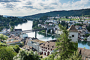 From Munot fortress, see the Rhine River flow through Schaffhausen, in Switzerland, Europe. Schaffhausen arose where trading ships had to set anchor because Rhine Falls blocked further travel.