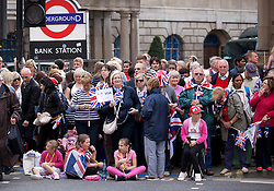 © Licensed to London News Pictures. 10/09/2012. LONDON, UK. Spectators are seen near Bank Station in London today (10/09/12) as they wait for a parade made up of British athletes who competed in the London 2012 Olympic and Paralympic Games. Photo credit: Matt Cetti-Roberts/LNP