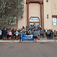 Participants in the Law Enforcement Torch Run pose for a group photo before beginning the run Saturday morning at the McKinley County Courthouse in Gallup.