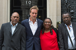 © London News Pictures. 22/05/15. London, UK. From L to R: Gianny Augustin, TV presenter and adventurer Ben Fogle, Sabrina Jean and Clifford Volfrin hand in a petition at 10 Downing Street calling for the Chagos islanders to be allowed to resettle on the islands, Westminster, Central London. Photo credit: Laura Lean/LNP