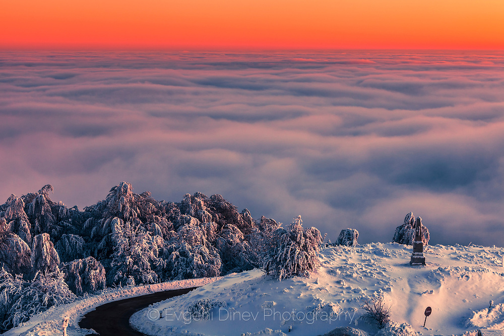 Mountain hill above the cover of clouds