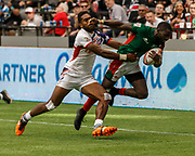 VANCOUVER, BC - MARCH 11: Matai Leuta (#4) of USA makes a strong tackle on Kenya ball carrier during Game # 40- United States vs Kenya Cup SF 2 match at the Canada Sevens held March 10-11, 2018 in BC Place Stadium in Vancouver, BC. (Photo by Allan Hamilton/Icon Sportswire)