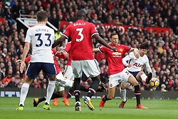 Tottenham Hotspur's Son Heung-Min has a shot blocked by Manchester United's Nemanja Matic during the Premier League match at Old Trafford, Manchester.