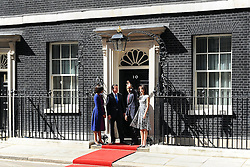© licensed to London News Pictures. LONDON, UK  24/05/11. Barak Obama, and Michelle Obama are met by David Cameron and Samantha Cameron in Downing Street during US President Obama's first State Visit to the United Kingdom. Please see special instructions. Photo credit should read Stephen Simpson/LNP