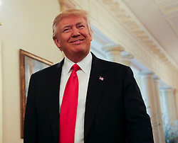 U.S. President Donald Trump arrives at the National Governors Association meeting in the State Dining Room of the White House, Washington, DC, February 27, 2017. (Pool / Aude Guerrucci)