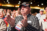 26 FEBRUARY 2011 - PHOENIX, AZ: A man applauds for Arizona State Senator Russell Pearce after Pearce spoke about undocumented immigration at the Tea Party Patriots American Policy Summit in Phoenix Saturday. The summit goes through Sunday Feb. 27. About 2,000 people are attending the event, which organizers said is meant to unite Tea Party groups across the country. Speakers include former Minnesota Governor Tim Pawlenty, Texas Congressman Ron Paul, former Clinton advisor Dick Morris and conservative blogger Andrew Brietbart. The event ends with a presidential straw poll Sunday.   Photo by Jack Kurtz