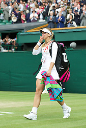 30.06.2011, Wimbledon, London, GBR, WTA Tour, Wimbledon Tennis Championships, im Bild Sabine Lisicki (GER) waves goodbye to the crowd after losing the Ladies' Singles Semi-Final match on day ten of the Wimbledon Lawn Tennis Championships at the All England Lawn Tennis and Croquet Club. EXPA Pictures © 2011, PhotoCredit: EXPA/ Propaganda/ David Rawcliffe +++++ ATTENTION - OUT OF ENGLAND/UK +++++
