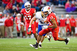 24 September 2011: Tyrone Walker makes his way with Mike Lien in pursuit during an NCAA football game between the South Dakota State Jackrabbits (SDSU) and the Illinois State Redbirds (ISU) at Hancock Stadium in Normal Illinois.