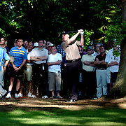 Phillip Price watches his shot on the 18th after shooting from the rough