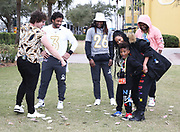 Seattle Seahawks quarterback Russell Wilson (3) (left) along with wife Ciara (right) and stepson Future Wilburn and cornerback Shaquill Griffin (26) are entertained by a trick from magician Julius Dein (far left) at the ESPN Wide World of Sports on Wednesday, Jan 22, 2020, in Kississimee, Fla. (Steve Jacobson/Image of Sport)