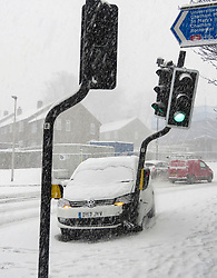 © Licensed to London News Pictures. 27/02/2018. Medway, UK. A car which has run off the road and hit traffic lights in heavy snow near Chatham in Medway, Kent South East England. Amber weather warnings are in place for large parts of the east of the UK as a severe cold front heads in from Russia. Photo credit: Graham Long/LNP