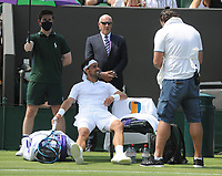 Tennis - 2021 All England Championships - Week One - Day Five (Friday) - Wimbledon<br /> Fabio Fognini v Andre Rublev<br /> <br /> Fabio Fognini of Italy in pain , waits for the physio<br /> <br /> CreditCOLORSPORT/Andrew Cowie