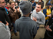 28 DECEMBER 2019 - DES MOINES, IOWA: Mayor PETE BUTTIGIEG, right, talks to a man who questioned his record on civil rights and police-community relations in South Bend during a meet and greet with Buttigieg in Des Moines. Buttigieg talked to a crowd of about 75 people at Urban Dreams, an African-American community empowerment center in Des Moines. It was a part of Buttigieg's continuing outreach to African-American voters. Buttigieg, the mayor of South Bend, Indiana, is running to be the Democratic nominee for President in the 2020 election. Iowa traditionally holds the first presidential selection event of the 2020 election cycle. The Iowa Caucuses are on Feb. 3, 2020.            PHOTO BY JACK KURTZ