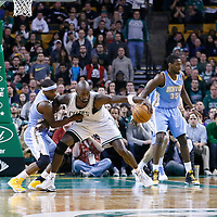10 February 2013: Denver Nuggets point guard Ty Lawson (3) defends on Boston Celtics power forward Kevin Garnett (5) during the Boston Celtics 118-114 3OT victory over the Denver Nuggets at the TD Garden, Boston, Massachusetts, USA.