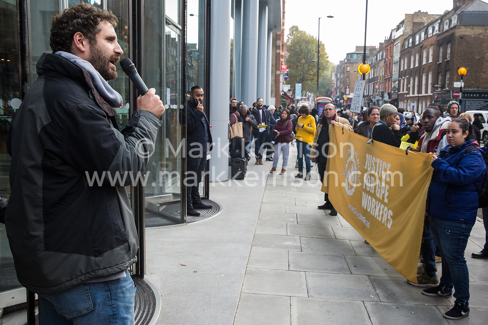 London, UK. 31 October, 2019. Petros Elia, co-founder of the United Voices of the World (UVW) trade union, addresses low-paid migrant cleaners who work in offices housing ITV and Channel 4 in Gray's Inn Road outsourced via City & Essex and belonging to UVW during a coordinated series of 'five strikes in one day' involving also cleaners from the Ministry of Justice, University of Greenwich café workers, cleaners, porters and caterers from St Mary's Hospital Paddington and park attendants from the Royal Parks. The City & Essex cleaners are seeking full sick pay and more annual leave.