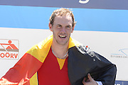 Linz. AUSTRIA.   Sunday A Finals, Men's medalist  single sculls, Silver Medalist, BEL BM1X. Hannes OBRENO is shown the medal by Gwenda STEVENS, Head of the Belgium Rowing Federation.  FISA U23 World Championships, Linz-Ottensheim Rowing Course.  12:24:33  Sunday  28/07/2013. [Mandatory Credit, Peter Spurrier/ Intersport Images] ,