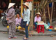 Vietnam -- March 23, 2016 Bargaining in a Street Market in Hoi An Vietnam.