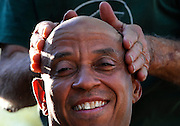 Client Jeffery Pettiford of Hartford, receives a massage of after-shave from from Anthony Cymerys in Hartford, Conn.