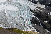 """Alerce Glacier. Cerro Tronador is an extinct stratovolcano in the southern Andes, near Bariloche, in the Lake District of Argentina. The sound of falling seracs gave it the name Tronador, Spanish for """"Thunderer."""" With an altitude of 3470 m, Tronador stands more than 1000 meters above nearby mountains in the Andean massif, making it a popular climb in Patagonia, South America. Located inside two National Parks, Nahuel Huapi in Argentina and Vicente Pérez Rosales in Chile, Tronador hosts eight glaciers, which are retreating due to warming of the upper troposphere."""