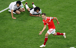 Russia's Denis Cheryshev celebrates scoring his side's second goal of the game during the FIFA World Cup 2018, Group A match at Saint Petersburg Stadium.