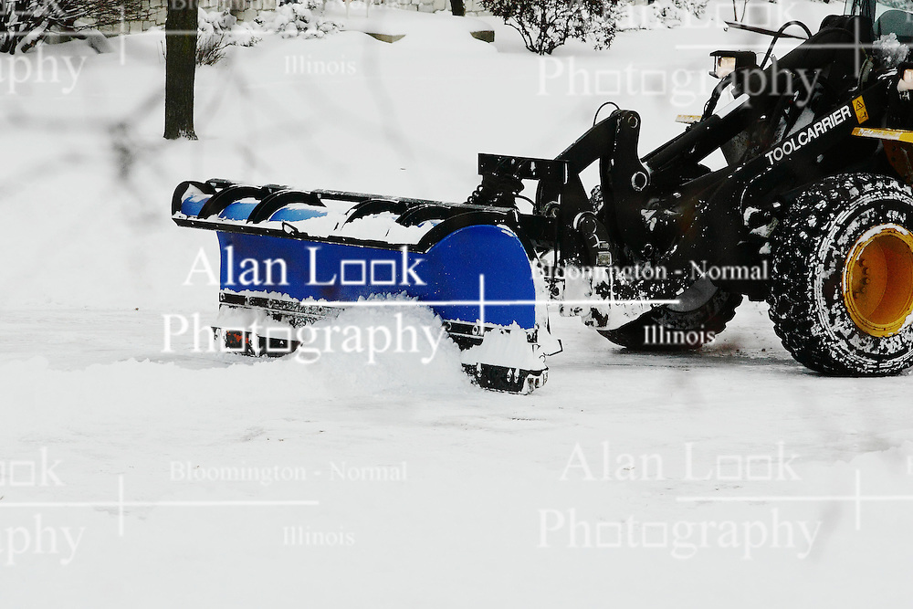 01 February 2008: An end loader with a snow plow clears the freshly fallen snow from a cul-de-sac in a subdivision in Bloomington Illinois This image available for EDITORIAL USE ONLY. A release may be required. Additional information by contacting alook at alanlook.com