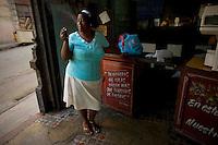 cuban woman smoking cigarette in restaurant