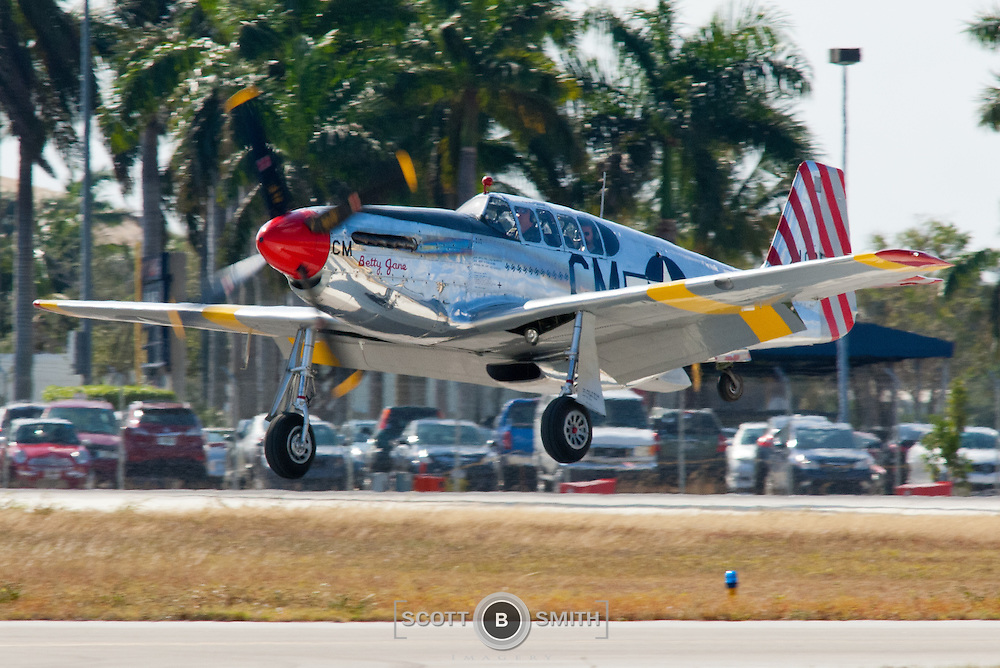 """The Collings Foundation's Mustang #42-103293 """"Betty Jane"""" was built in Dallas, TX. #42-103293 went though a meticulous restoration from 2000 to 2004. During restoration the Mustang was rebuilt as a two-seat version of the P-51C. The two-seat P-51C was a field modification that added a second seat for use as a high-speed transport and to allow ground crew to fly. At least five P-51B/Cs were converted during WWII for VIP transport. One of the most famous of these modified two seat fighters was used by Dwight Eisenhower and was named """"The Stars Look Down"""". Ike rode in the back seat of that Mustang over the beaches of Normandy to direct the invasion during D-Day. The Collings Foundation's Dual Control TP-51C """"Betty Jane"""" is the only one of its type in existence today that features a full set of dual controls."""
