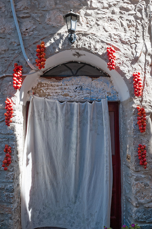 Tomatoes hung to dry on a wall of an old house in the village of Mesta in Chios, Greece.