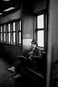 Man in fedora and cowboy boots smoking on the Staten Island Ferry (1985)