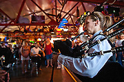 """Jessica Bryant with the Coeur d'Alene Firefighter Pipe and Drum group belts out the tune of """"Amazing Grace"""" during the opening of Cruiser's Mini-Sturgis motorcycle rally in Stateline on Thursday"""