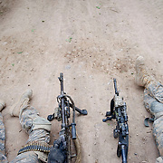 American soldiers guarding a road while an explosive ordinance disposal (EOD) team clears an improvised explosive device from a road in Arghandab District west of Kandahar City, Afghanistan.(Credit Image: © Louie Palu/ZUMA Press).